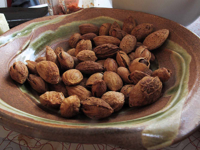 a plate of roasted spiced almonds, popular chinese new year snacks