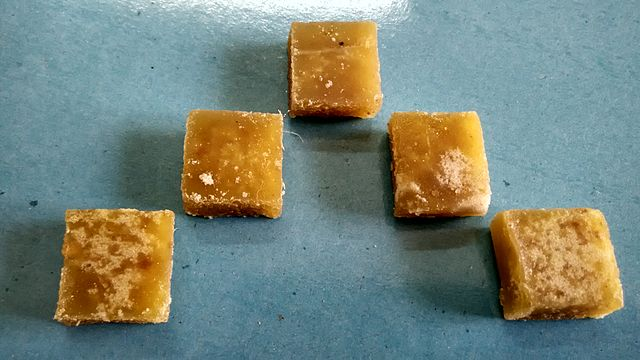 five square pieces of ginger candy