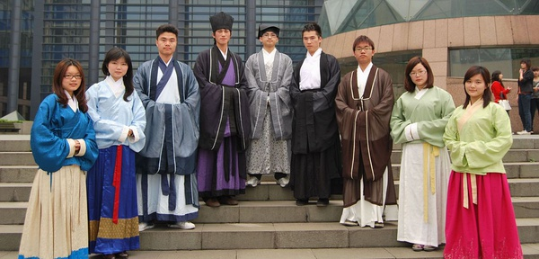 a group of people on a staircase wearing hanfu outfits