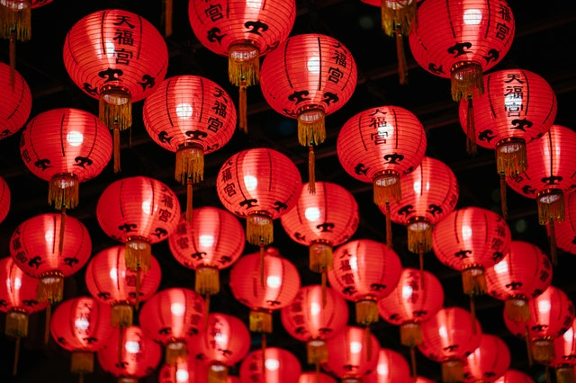 red lanterns, a subject of many chinese new year myths, with chinese characters illuminated by light bulbs