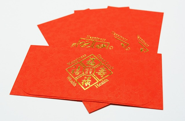 a stack of four red pockets