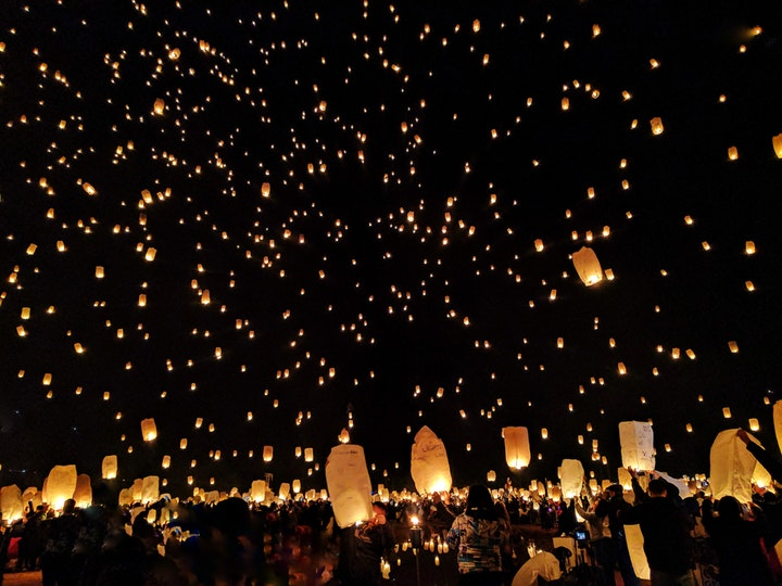 hundreds of sky lanterns released into the sky during the lantern festival