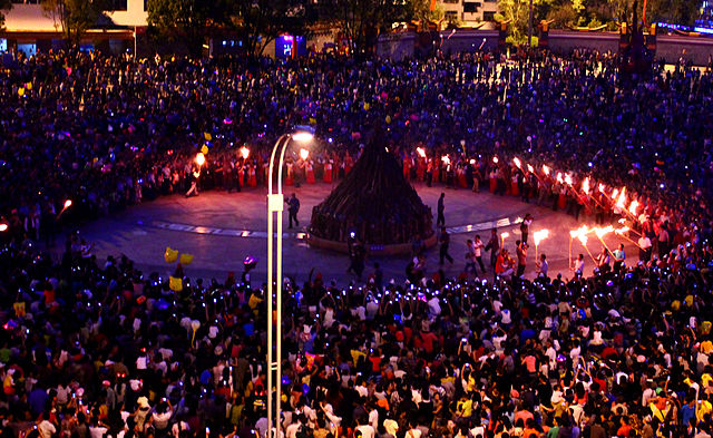 lantern festival: a community gathered together with some holding up torches