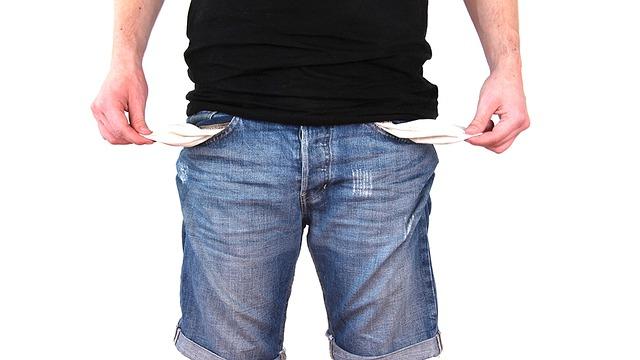 a man grabbing his empty pockets