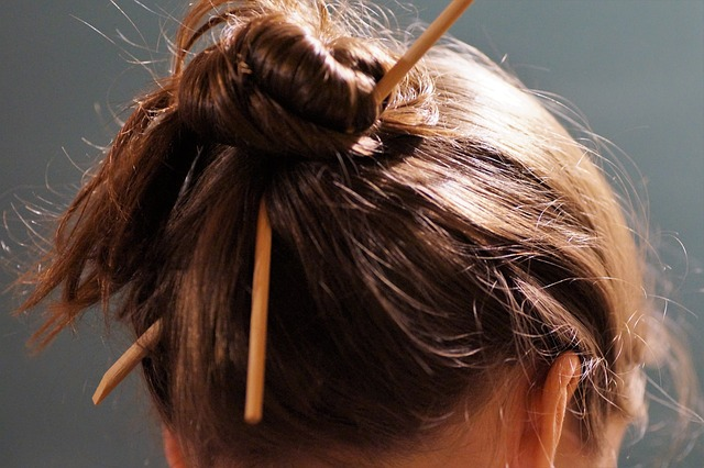 a pair of thin sticks used as hair accessories